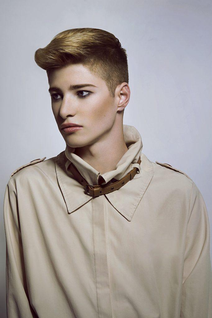 Androgynous male model in khaki shirt.