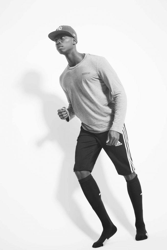 Black athlete leaning forward.