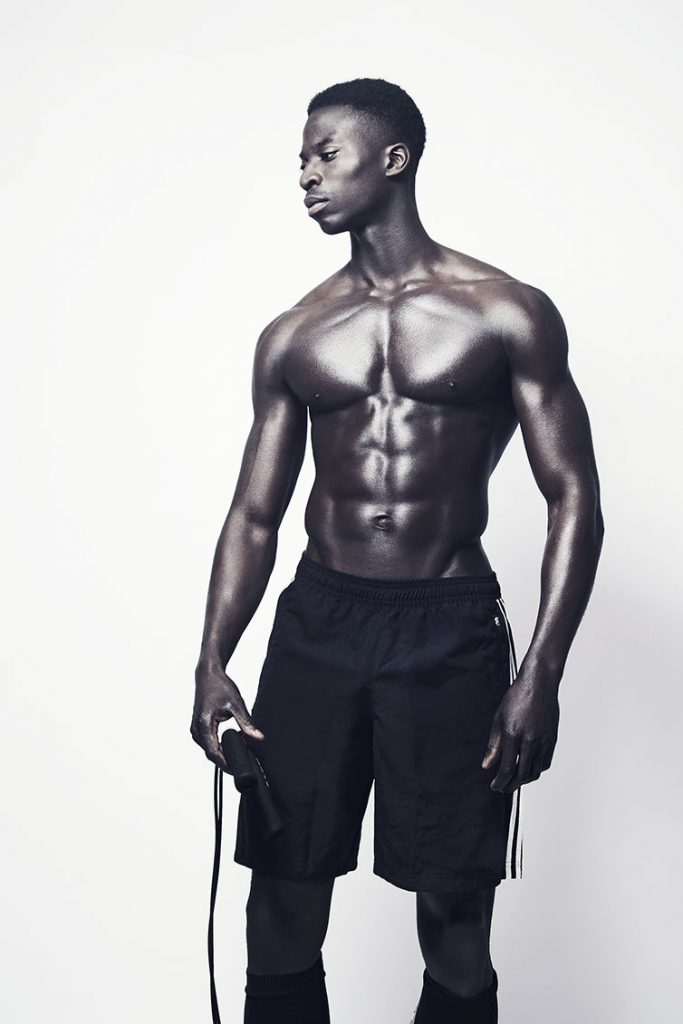 Shirtless black athlete.