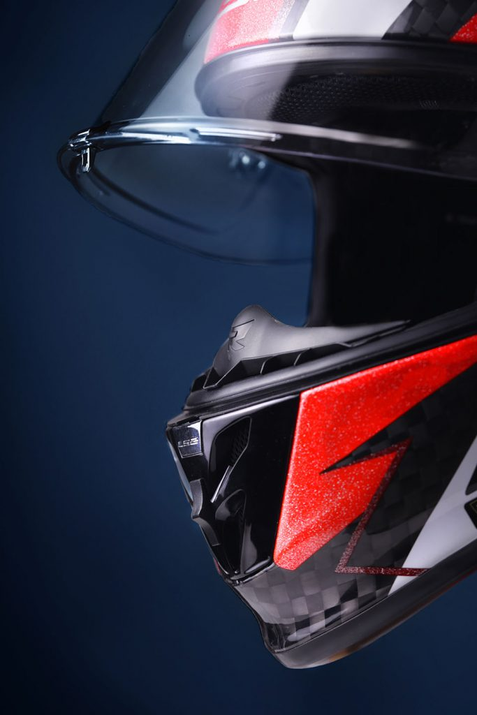 Close-up of red and black motorbike helmet.
