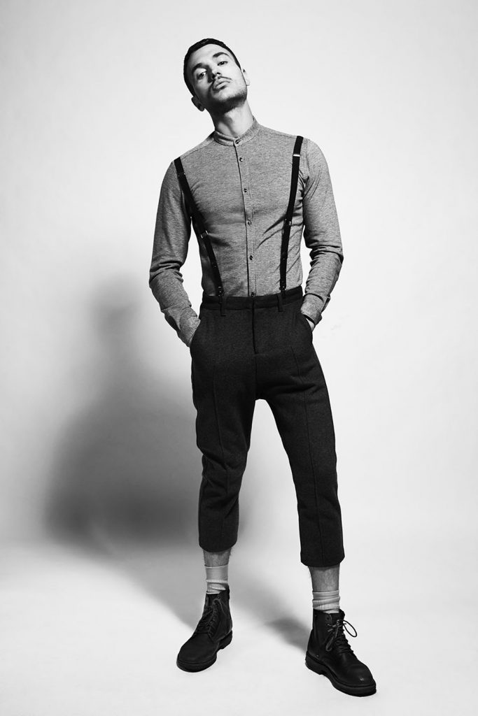 Male model wearing vintage clothes with suspenders.