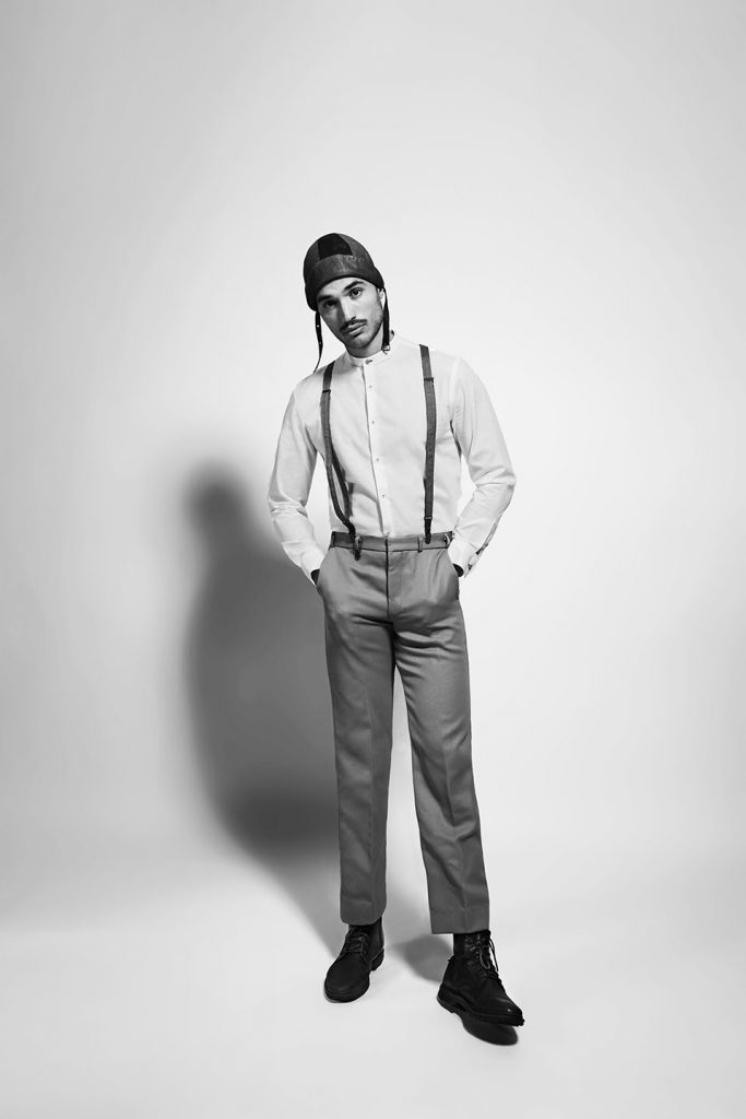 Male model wearing vintage shirt and pilot hat.